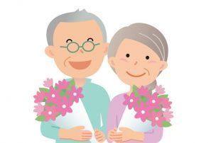 敬老の日にお花をもらうおじいちゃんとおばあちゃん